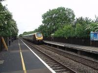 The period style lighting adds a nice touch to Tackley station as a Cross Country Voyager speeds south on the line from Banbury to Oxford. This view looks north towards Banbury.<br><br>[Mark Bartlett&nbsp;18/06/2009]