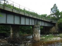 The trackbed from Craigellachie to Dufftown is now part of the Speyside Way and this viaduct over the River Fiddich is at the east end of the station site right at the start of the walk, a steady climb of about four miles. A small platform attached to the structure still has some surviving signal pulleys.<br><br>[John Gray&nbsp;27/07/2009]