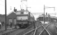 E26053 <I>Perseus</I> with the RCTS <I>Great Central Railtour</I> at Penistone station on 13 August 1966. The train is preparing to leave for Sheffield Victoria following which the electric locomotive will hand over to steam haulage for the journey south to Marylebone via the GC London extension.<br> <br><br>[K A Gray&nbsp;13/08/1966]