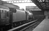 Black 5 no 45084 of Stirling South shed stands at the buffer stops at Glasgow Buchanan Street on 23 August 1965.<br><br>[K A Gray&nbsp;23/08/1965]