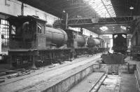 North Eastern line up inside the repair shop at Gateshead on 24 October 1964 with 65791 nearest the camera on the left, 65832 beyond that and 63455 at the end of the line.<br><br>[Robin Barbour Collection (Courtesy Bruce McCartney)&nbsp;24/10/1964]