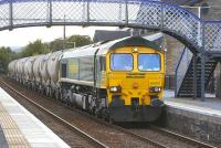 Freightliner 66601 <I>The Hope Valley</I> slows for a signal check at Blair Atholl with the 6B31 Inverness-Oxwellmains empty cement tanks on 30 July. This train currently runs only once or twice a month due to the recession.<br> <br><br>[Bill Roberton&nbsp;30/07/2009]