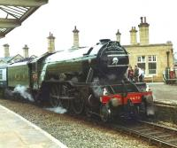 4472 <I>Flying Scotsman</I> struggles to round Shipley station west to south curve with the empty stock of <I>The North Yorkshireman</I> heading from Keighley to Bradford Forster Square in June 1981.<br><br>[David Pesterfield&nbsp;30/06/1981]