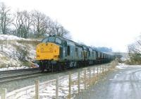 A pair of class 37s with an eastbound coal train at Beith North in 1986.<br> <br> <br><br>[Colin Miller&nbsp;//1986]