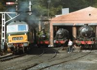 Hymek D7029 accelerates south from Grosmont tunnel on 21 August 1984 with a train for Pickering, passing 69023, 45428 and 62005 standing on shed.<br><br>[David Pesterfield&nbsp;21/08/1984]