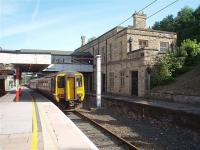 Although the former Platform 6 at Lancaster Castle is disused the first floor of the original station building is still the booking office, operated by Virgin, and from where the platforms are accessed via the footbridge. 156480 stands in Platform 5 waiting to form a Northern service to Barrow in Furness in this view looking northwards. <br><br>[Mark Bartlett&nbsp;31/07/2009]
