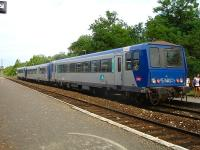 The heavily loaded 19.09 3-car DMU service to Sarlat, ex-Libourne, with car 2221 at the rear, offloads at Velines Station on 13 July 2009. Two reminders of home on the rear of and to the right of the last coach.<br><br>[David Pesterfield&nbsp;13/07/2009]