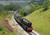 KWVR Summer Steam Gala, June 2009, with WD 2-8-0 no 90733 approaching Mytholmes Tunnel with the 1150 service from Keighley to Oxenhope.<br><br>[Andy Carr&nbsp;26/06/2009]