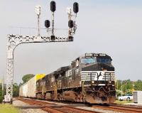 A trio of locomotives with a northbound freight, headed by D9-40CW no 9591, rumbles through downtown Easley, South Carolina, on the Norfolk Southern Railway <I>Crescent Line</I> in August 2009.<br><br>[Andy Carr&nbsp;07/08/2009]