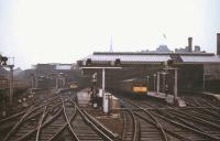 View from the window of a railtour approaching Newcastle Central in May 1967 as the light begins to fade. One of the North Tyneside third-rail DC electric services stands in the bay, destination <i>'Coast'</i>, shortly before the line was de-electrified and DMUs took over these operations. The North Tyneside line was, of course, subsequently re-electrified in the early 1980s and is now part of the Tyne & Wear Metro system.<br> <br><br>[Colin Miller&nbsp;/05/1967]