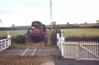 Another shot of what was intended to be the last Langholm/Newcastleton pickup freight in August 1967, with the additional enthusiasts brake van attached. The ensemble is seen here at Gilnockie level crossing on its way from Riddings Junction to Langholm. <br><br>[Bruce McCartney&nbsp;/08/1967]
