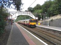Looking across the tracks towards the northbound platform at Bearsden on 8 August as 318 259 arrives on a service for Milngavie.<br><br>[David Panton&nbsp;08/08/2009]