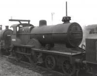 Fowler 2P no 40694 stored minus tender on Bescot shed awaiting disposal on 2 December 1962 having been officially withdrawn the previous month. The locomotive was eventually cut up at Crewe in July 1963.<br> <br><br>[David Pesterfield&nbsp;02/12/1962]
