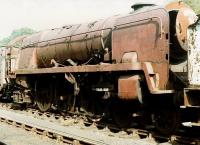 Bulleid <I>West Country</I> light Pacific no 34010 <I>Sidmouth</I> standing alongside Grosmont shed in 1984, some two years after recue from Woodham's scrapyard. The locomotive was later purchased by Southern Locomotives Ltd and moved to Sellindge in Kent in 1997, where it is awaiting restoration.<br> <br><br>[David Pesterfield&nbsp;21/08/1984]
