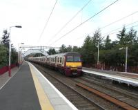 A six car 320 formation arrives at Clydebank on 8 August 2009, destination Springburn. The named sets are <I>High Road 20th Anniversary 2000</I> followed by <I>Royal College of Physicians and Surgeons of Glasgow</I>.<br> <br><br>[David Panton&nbsp;08/08/2009]