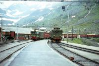 Scene on the Flam Railway at Myrdal in July 1967 with a Bergen - Oslo train arriving on the main line as the locomotive of the Flam branch train runs round.<br><br>[Colin Miller&nbsp;/07/1967]