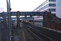 Looking west from a DMU leaving Southampton Central on a Saturday afternoon in May 1985. A Brush Type 4 is at the head of a service on the right, with a 2 car EMU standing alongside.<br><br>[John McIntyre&nbsp;/05/1985]