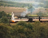 An InterCity 125 HST on an ecs movement heads south towards Sheffield passing Crigglestone Junction signal box in September 1987.<br><br>[David Pesterfield&nbsp;/09/1987]