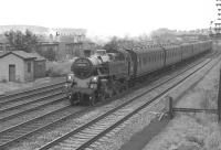 A Wemyss Bay to Glasgow express passenger service, hauled by a remarkably clean looking 80086, runs through Hillington West on the up fast line in August 1963.<br><br>[Colin Miller&nbsp;/08/1963]