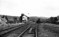 Looking north towards Grantown on Spey with Boat of Garten North signal cabin standing over the remaining track work on 06 April 1973 in the early days of preservation by the Strathspey Railway. The point on the right had connected to the ex GNoSR line to Nethy Bridge but the scrapmen had truncated it just beyond the ex CR crane. The reason for the facing point lock here was to permit passenger services to run through from Aviemore to Craigellachie when the Speyside service was extended from Boat of Garten in BR days. On the ex HR line, a rail has been removed from each side beyond the point and at the north end of the loop the track had been lifted immediately after the point.<br><br>[John McIntyre&nbsp;06/04/1973]