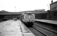 Looking south along platform 6 at the north end of Aberdeen Joint station as a Swindon DMU waits to depart for Inverness on 9 June 1973. The old GNoS booking office is on the right and the main part of the station is beyond Guild Street bridge. Hopefully the tail lamp will be moved to the rear of the train before departure!<br><br>[John McIntyre&nbsp;09/06/1973]