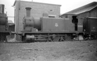 One of the McIntosh ex-Caledonian 2F 0-6-0 dock tanks (known as <I>Beetle Crushers</I> due to their sturdy appearance) no 56164 on Grangemouth shed, in April 1958, the year of its official withdrawal by BR. The precise location is on the long outside road between the shed building and the ex CR line to Swing Bridge Junction (Camelon) via Bainsford. The locomotive was cut up at Kilmarnock works in July 1959. [See image 26436]<br> <br><br>[Robin Barbour Collection (Courtesy Bruce McCartney)&nbsp;18/04/1958]
