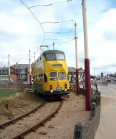 Blackpool Transport double deck <I>Balloon Car</I> No. 711 negotiates the sand filled turning circle at Starr Gate to head for Fleetwood. The bridge in the background carries the road over the Blackpool South railway line and marks the entrance to Squires Gate station. Shortly after this image was taken the tracks were lifted to allow a refurbishment in connection with the new tram depot construction. 711 was later rebuilt with wider entrances to be compatible with the new platforms. [See image 54343]<br><br>[Mark Bartlett&nbsp;11/08/2009]