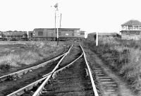 An EE Type 3 heads south towards the Tyne in 1971 with a coal train, probably from Burradon exchange sidings. The train is about to pass Earsdon Junction signal box. The flat crossing is a mineral line (the Backworth Wagonway) serving East Holywell Colliery.<br> <br><br>[John Furnevel&nbsp;19/10/1971]