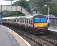 Scene at Hillfoot on 8 August 2009, with 320 310 on a High Street service.<br><br>[David Panton&nbsp;08/08/2009]
