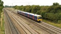 166201 eastbound for Paddington on 18 August, taken from a farmer's overbridge to the east of Didcot. A very good spot for a lot of train movements, especially if you like a zillion DMUs and HSTs!<br> <br><br>[Peter Todd 18/08/2009]
