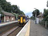156 476 calls at Pollokshaws West with a train for East Kilbride on 8 August 2009.<br><br>[David Panton&nbsp;08/08/2009]