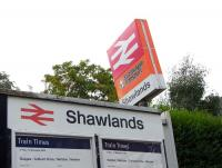 Photograph taken at Shawlands station on 8 August 2009 showing the orange image before last, and in front of it, the pre-Strathclyde branding image before that.<br><br>[David Panton&nbsp;08/08/2009]