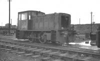 NBL Class D2/10 diesel hydraulic 0-4-0 D2730 of St Margarets shed in the yards at Leith South in the early 1960s. In the left background is part of the coaling stage of Seafield shed, the facility built by the Caledonian in 1902. It was subsequently leased to the NB and eventually became an outpost for St Margarets freight locomotives prior to eventual demolition in 1966. In the right background is part of the embankment that carried the Caledonian line up to the bridge over Seafield Road.<br><br>[K A Gray&nbsp;//]