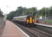 Calling at Ashfield station on 8 August 2009 is unit 156 445 with a service on the short Glasgow Queen Street to Anniesland route, with an end to end journey time of just 14 minutes.<br><br>[David Panton&nbsp;08/08/2009]