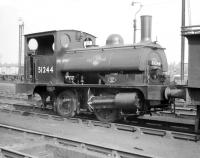 One of the attractive Aspinall ex-L&YR 0-4-0ST <I>Pugs</I> used for shunting in and around the extensive Goole docks, where it spent almost its entire life. Seen here (minus various crucial parts) standing in the shed sidings in the early 1960s. It was officially withdrawn from 53E in March of 1962 and cut up at Crewe works the following month.<br><br>[Robin Barbour Collection (Courtesy Bruce McCartney)&nbsp;//1960]