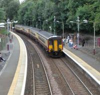 A 4-car 156 pulls into Thornliebank with an East Kilbride - Glasgow service on Saturday 8 August 2009. Now a mad dash so I can catch it...<br><br>[David Panton&nbsp;08/08/2009]