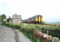 A little to the east of Kents Bank station is a level crossing affording tractors access to the foreshore. The crossing cottage still stands but these days the barriers are 'user operated'. 156444 heads for Lancaster on a Northern coastal service.<br><br>[Mark Bartlett&nbsp;24/08/2009]