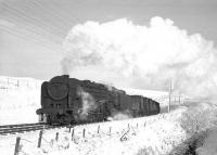 Britannia Pacific no 70035 <I>Rudyard Kipling</I> passing a snowy Whitrope Summit in November 1964 with the 8.16am Millerhill - Carlisle freight. <br><br>[Robin Barbour Collection (Courtesy Bruce McCartney)&nbsp;28/11/1964]