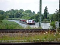An earlier mode of transport passes under the railway at Lubeck in July 2009.<br><br>[John Steven&nbsp;/07/2009]