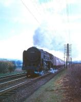 Britannia Pacific no 70046 <I>Anzac</I> photographed shortly after passing below the road bridge (in background) just to the north of Beattock station with a down train in the mid 1960s.<br><br>[A Snapper (Courtesy Bruce McCartney)&nbsp;//]