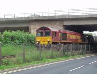 66133 draws its train of empty bitumen tankers out of the exchange sidings at Preston Dock and is off back to Lindsey Refinery near Immingham. The loaded tanks it has just delivered will be taken to the unloading siding by the RSR shunter. [See image 25133]<br><br>[Mark Bartlett&nbsp;21/08/2009]