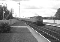 A northbound <I>Motorail</I> service passes through Carluke behind a Brush Type 4 locomotive in July 1965.<br><br>[Colin Miller&nbsp;/07/1965]