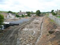 Ongoing site preparation at Caldercruix on 28 August with the old platforms and the former lineside housing to the south now demolished [See image 21918]. View west from Main Street road bridge towards Drumgelloch.<br> <br><br>[John Furnevel&nbsp;28/08/2009]