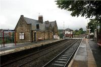 The beautifully restored station building and signalbox stand on the north side of the line at Parbold between Southport and Wigan on 26 August 2009. The end of the station building nearest the camera is still in use as ticket office, waiting room and toilets.<br><br>[John McIntyre&nbsp;26/08/2009]