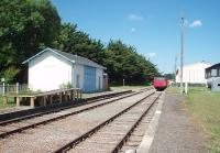 This preserved French railway known as the Gulls' Line operates a steam service on Sundays over the twelve miles from Saujon to La Tremblade. Passengers are carried in converted goods wagons, as seen here at the intermediate station of Chaillevette where the depot and workshop are sited. View north westwards towards La Tremblade. <br><br>[Mark Bartlett 22/06/2009]