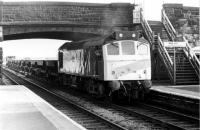 25153 brings its train of ballast hoppers to a halt in Burscough Bridge station, prior to setting them back onto the Burscough Junction chord to allow a DMU to pass [See image 22975]. The chord has since been lifted and the <I>Rip Raps</I> no longer clatter round the North West. 25153 was withdrawn in 1983, after some 19 years service, and cut up at Swindon four years later.<br><br>[Mark Bartlett&nbsp;03/11/1980]