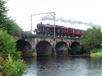 Heavy rain again for <I>Leander</I> on the <I>Fellsman</I> as it crosses the River Wyre at Scorton on the outbound leg. This bridge is known locally as Six Arches, five arches being over the river and the sixth over the access road to a caravan site of the same name. <br><br>[Mark Bartlett&nbsp;02/09/2009]