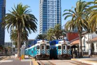 San Diego <I>Coaster</I> car cab units no 2302 and 2310 stand at the Santa Fe Depot in downtown San Diego, CA on 18 August 2009.� A <I>Coaster</I> set typically consists of a locomotive and 5 or 6 double-deck coaches.� The service links San Diego and Oceanside, CA to the north.� A one-way trip takes about 60 minutes and stops are made at 6 intermediary stations along the line.<br><br>[Andy Carr&nbsp;18/08/2009]