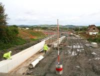 Construction activity alongside Station Road, Armadale on 28 August 2009. View is north east from the B8084 road bridge along the trackbed towards Bathgate.<br> <br><br>[John Furnevel 28/08/2009]