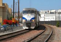 AMTRAK F59PHI no 459 has just received the all clear to run south over Cedar Street crossing in San Diego, CA on 15 August 2009.� The train will shortly enter the Santa Fe Depot where it will form the northbound <I>Pacific Surfliner</I> service #577, the 1255 to Los Angeles.<br><br>[Andy Carr&nbsp;15/08/2009]